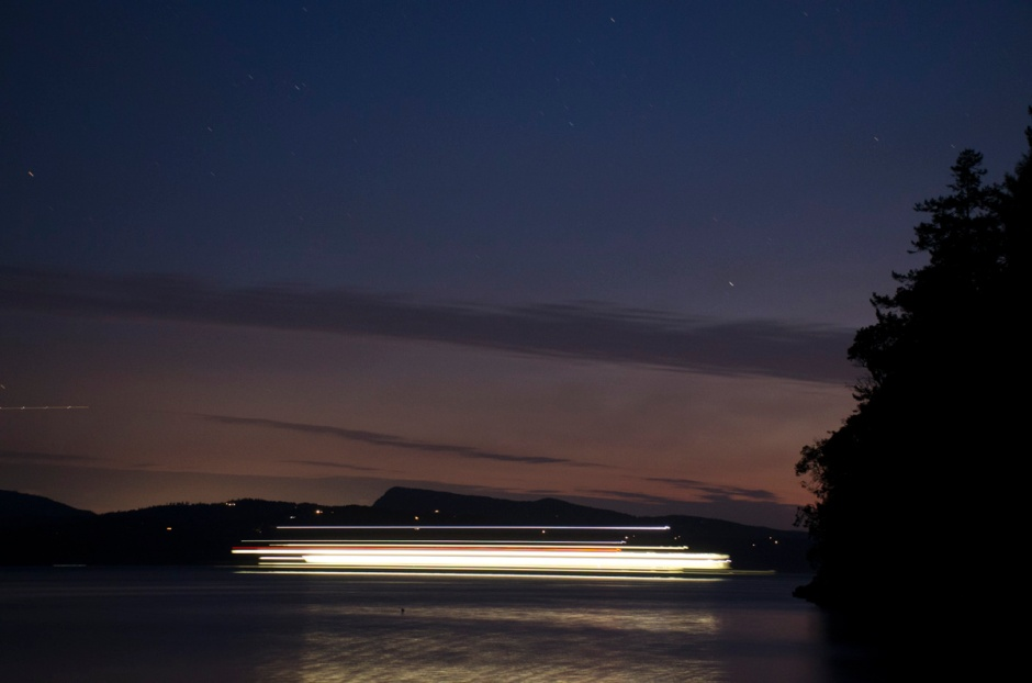 image of BC Ferry passing Roesland at night