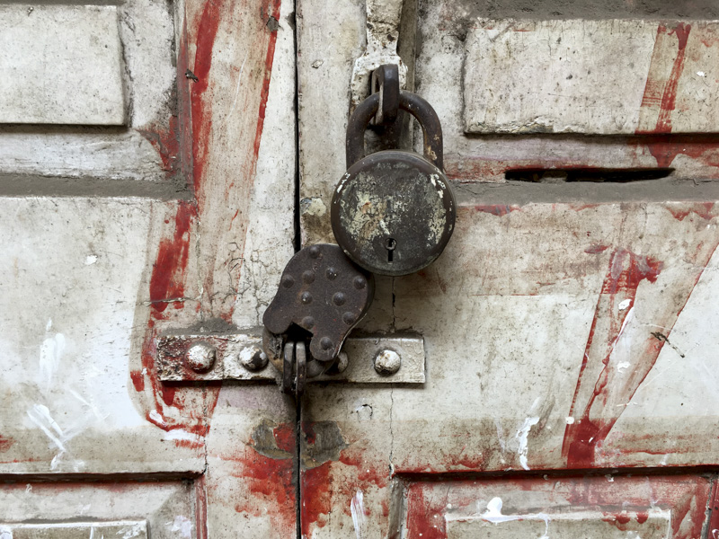 locks on a painted door in Mumbai, India
