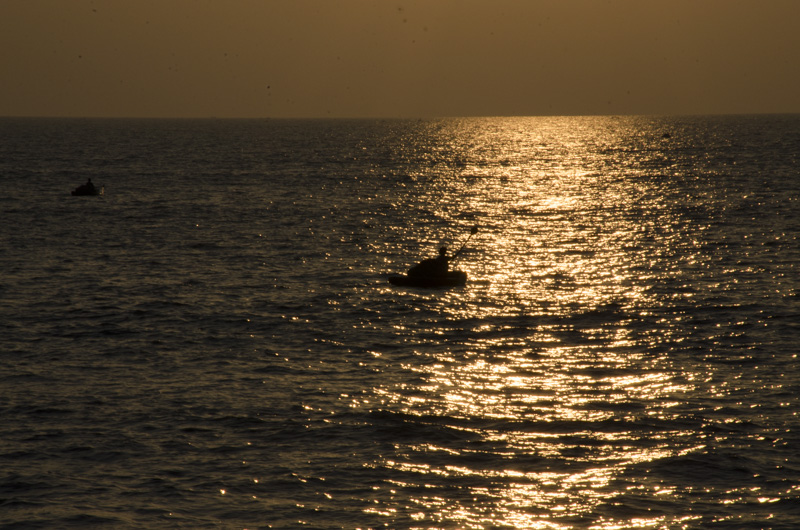 Fisherman at Sunset from Marari Beach, Kerala, India
