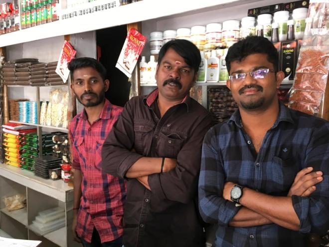 helpful staff at Farmers Spice Market, Kumily, India