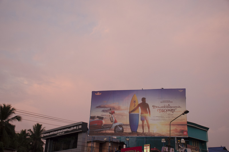 sunset and a billboard near Trivandrum, India