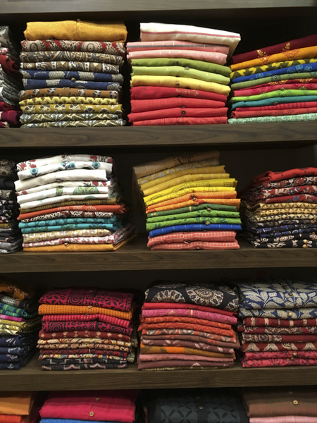 Colourful clothing display at Cotton Cottage