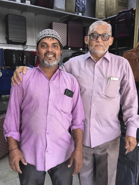 salesmen at Crawford Market luggage shop